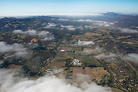 aerial photograph of northern Napa Valley, Napa County, California toward Mount St. Helena;  the Beringer Production Facility is in the foreground right; the Charles Krug Winery in the center, the Culinary Institute of America is at left above the Beriginer Facility, the Napa River is at the right, adjacent to the Silverado Trail
