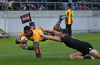 Australia's Filipo Daugunu beats NZ's George Bridge to score during the Bledisloe Cup rugby union match between the New Zealand All Blacks and Australia Wallabies at Sky Stadium in Wellington, New Zealand on Sunday, 11 October 2020. Photo: Mike Moran / lintottphoto.co.nz