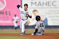 Asheville Tourists second baseman Terrin Vavra (6) makes the turn on a double play over a hard sliding Mikey Edie (46) during a game against the Augusta GreenJackets at McCormick Field on June 5, 2019 in Asheville, North Carolina. The Tourists defeated the GreenJackets 4-3. (Tony Farlow/Four Seam Images)