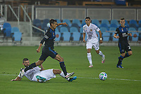 SAN JOSE, CA - SEPTEMBER 13: Chris Wondolowski #8 of the San Jose Earthquakes dribbles the ball past Perry Kitchen #2 of the L.A. Galaxy during a game between Los Angeles Galaxy and San Jose Earthquakes at Earthquakes Stadium on September 13, 2020 in San Jose, California.