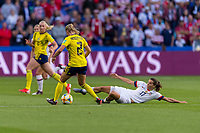 LE HAVRE,  - JUNE 20: Jonna Andersson #2 is tackled by Tobin Heath #17 during a game between Sweden and USWNT at Stade Oceane on June 20, 2019 in Le Havre, France.