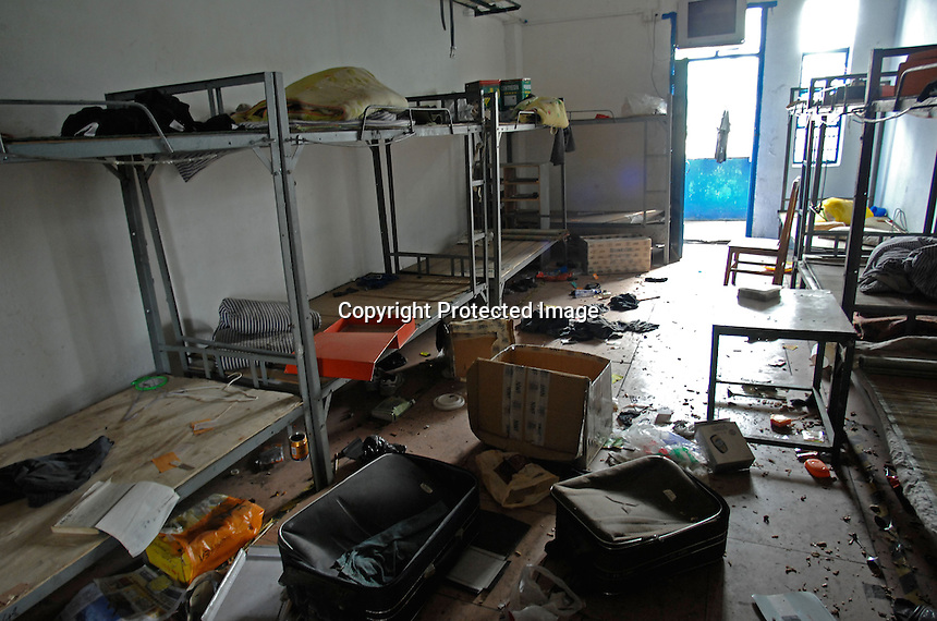 """Ransacked and desterted dormitories in Dingfu Factory in Houjie Town, Donguan, China.  A sign outside the factory that made shoes for Zara and Nine West amongst others, reads that the """"Donguan People's Court have closed the factory"""" .  As the economy changes and Chinese labour gets more expensive, factories are cosing leaving ghost towns behind them.<br /> <br /> MUST CREDIT PHOTO BY RICHARD JONES/SINOPIX"""