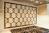 This custom kitchen features a half scale Seine mosaic backsplash shown in waterjet Emperador Dark and Botticino from the Silk Road collection by Sara Baldwin for New Ravenna.