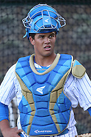 Darrell Miller Jr. #31 of the UCLA Bruins during a game against the Cal Poly Mustangs at Jackie Robinson Stadium on February 22, 2014 in Los Angeles, California. Cal Poly defeated UCLA, 8-0. (Larry Goren/Four Seam Images)