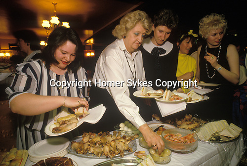 South London. 1980's<br /> Ladies tucking into hen party pub grub at Duke of Cambridge.