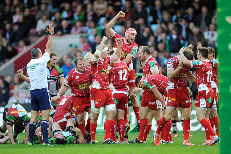 Joe Snyman of Scarlets (centre) celebrates winning the Heineken Cup Round 1 match between Harlequins and Scarlets at the Twickenham Stoop on Saturday 12th October 2013 (Photo by Rob Munro)
