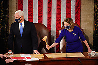 Speaker of the House Nancy Pelosi (R) and Vice President Mike Pence (L) convene a joint session of Congress to certify Joe Biden as the next US president in the US capitol in Washington, DC, USA, 06 January, 2021. President Donald J. Trump has refused to concede the election and is encouraging a group of lawmakers, along with Vice President Mike Pence, to back his baseless claims of voter fraud by overturning election results.<br /> Credit: Jim LoScalzo / Pool via CNP/AdMedia