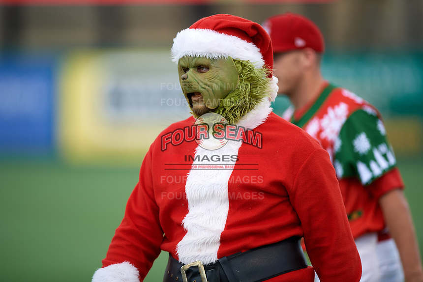 """The grinch during a Palm Beach Cardinals game against the Charlotte Stone Crabs on July 22, 2017 at Roger Dean Stadium in Palm Beach, Florida.  The Cardinals wore special """"Ugly Sweater"""" jerseys for Christmas in July.  Charlotte defeated Palm Beach 5-2.  (Mike Janes/Four Seam Images)"""