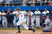 Jake Mueller (6) of the Wake Forest Demon Deacons follows through on his swing against the Florida Gators in Game Two of the Gainesville Super Regional of the 2017 College World Series at Alfred McKethan Stadium at Perry Field on June 11, 2017 in Gainesville, Florida.  (Brian Westerholt/Four Seam Images)