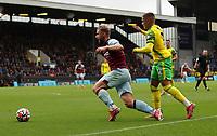 2nd October 2021;  Turf Moor, Burnley, Lancashire, England; Premier League football, Burnley versus Norwich City: Max Aarons of Norwich City brings down Charlie Taylor of Burnley