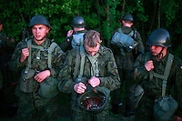 Young soldiers exercising outside their base. This year's class of drafted recruits is the final one after 90 years of compulsory military service, as Poland's army turns professional in 2009.