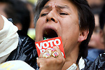 """A supporter of Andres Manuel Lopez Obrador shouts the slogan """"Vote by Vote"""" during a rally in front of the Federal Electoral Tribunal (TRIFE), August 7, 2006. Lopez Obrador staged a protest in front of the TRIFE to keep up pressure on authorities, after they voted on Saturday to recount ballots in just over 9 percent of the country's polling places. Photo by Heriberto Rodriguez."""