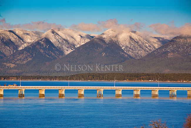 The bridge across the outlet of Flathead Lake at Polson, Montana with the Mission Mountains across the lake