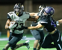 Sam Franklin (23) of  Little Rock Central stiff arms Cooper Martin (13) of Fayetteville at Harmon Stadium, Fayetteville, Arkansas on Friday, November 13, 2020 / Special to NWA Democrat-Gazette/ David Beach