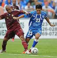 El Salvador midfielder Luis Anaya (23) shields the ball against Venezuela midfielder Jesus Lugo (11). El Salvador National Team defeated Venezuela 3-2 in an international friendly at RFK Stadium, Sunday August 7, 2011.
