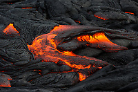 Lava Field: Lava flows and creates new land in the middle of the lava field, 61g flow field, Hawai'i Volcanoes National Park, Big Island.