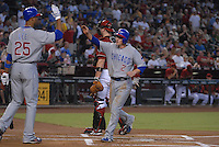 Aug 26, 2007; Phoenix, AZ, USA; Chicago Cubs shortstop (2) Ryan Theriot is congratulated by first baseman (25) Derek Lee after scoring on a throwing error by Arizona Diamondbacks shortstop Stephen Drew (not pictured) in the first inning at Chase Field. Mandatory Credit: Mark J. Rebilas-US PRESSWIRE Copyright © 2007 Mark J. Rebilas