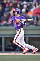 Clemson Tigers shortstop Eli White (4) swings at a pitch during a game against the South Carolina Gamecocks at Fluor Field February 28, 2015 in Greenville, South Carolina. The Gamecocks defeated the Tigers 4-1. (Tony Farlow/Four Seam Images)
