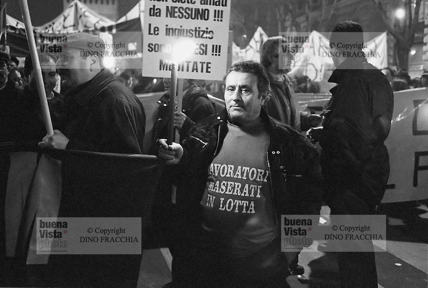 - Milan, workers of Innocenti - Maserati cars factory demonstrate against the dismissals for the plant closing (December 1992)....- Milano, gli operai della fabbrica di automobili Innocenti - Maserati manifestano contro i licenziamenti per la chiusura dello stabilimento (dicembre 1992)