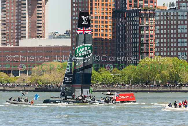 The Land Rover BAR Team UK catamaran races on the Hudson River near Brookfield Place in the America's Cup World Series.