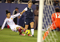 BOCA RATON, FL - DECEMBER 15, 2012: Lauren Cheney (12) of the USA WNT tries to get a shot past Wang Dongni (14) of China WNT during an international friendly match at FAU Stadium, in Boca Raton, Florida, on Saturday, December 15, 2012. USA won 4-1.
