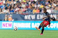 FOXBOROUGH, MA - JULY 7: Maciel #13 of New England Revolution passes the ball during a game between Toronto FC and New England Revolution at Gillette Stadium on July 7, 2021 in Foxborough, Massachusetts.