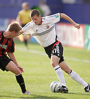 D.C. United's Joshua Gros gets Chris Leitch of the MetroStars turned around. The MetroStars played D.C United to a 0 -0 tie at Giant's Stadium, East Rutherford, NJ, on June 12, 2005.