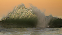 A wave stretches at Huntington beach