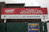 The sign at the main entrance to the ground during AFC Wimbledon vs Stevenage, Sky Bet League 2 Football at the Cherry Red Records Stadium, Kingston, England on 12/12/2015