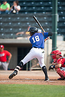 Missoula Osprey center fielder Kristian Robinson (18) at bat in front of catcher Griffin Barnes (28) during a Pioneer League game against the Orem Owlz at Ogren Park Allegiance Field on August 19, 2018 in Missoula, Montana. The Missoula Osprey defeated the Orem Owlz by a score of 8-0. (Zachary Lucy/Four Seam Images)
