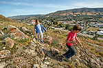 The kids hiking our mountain with a few of the sprawling city below.