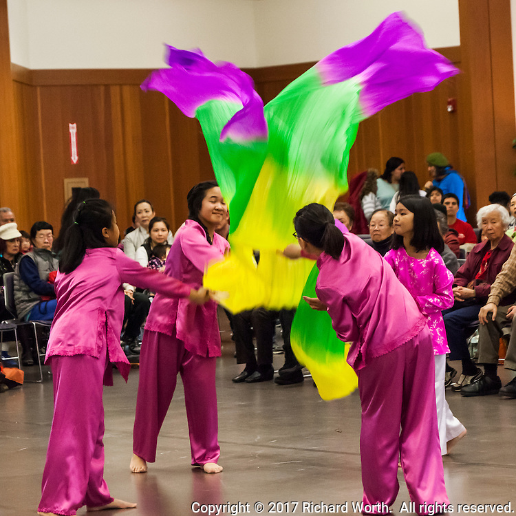 Dancers in pink swirling color for the Lunar New Year.