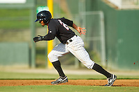Jacob May (20) of the Kannapolis Intimidators takes off for second base against the Rome Braves at CMC-Northeast Stadium on August 25, 2013 in Kannapolis, North Carolina.  The Intimidators defeated the Braves 9-0.  (Brian Westerholt/Four Seam Images)