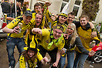 Fans cheering  because their favorite soccer club BVB 09  won the title in the German Premium League.