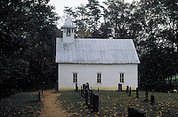 Old country church with graveyard, headstones. Cades Cove Tennessee United States.