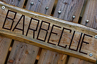 A wooden Barbecue sign in Aberporth