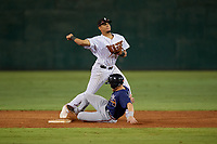 Jackson Generals second baseman Ramon Hernandez (12) throws to first base as Ryan Casteel (26) slides in during a Southern League game against the Mississippi Braves on July 23, 2019 at The Ballpark at Jackson in Jackson, Tennessee.  Mississippi defeated Jackson 1-0 in the second game of a doubleheader.  (Mike Janes/Four Seam Images)