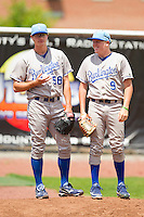 Burlington Royals relief pitcher John Walter (58) and Dan Stumpf (9) watch the action from the bullpen during the Appalachian League game against the Princeton Rays at Hunnicutt Field on July 15, 2012 in Princeton, West Virginia.  The Royals defeated the Rays 2-0 in game one of a double header.  (Brian Westerholt/Four Seam Images)