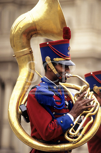 Lima, Peru. Guardsman playing the sousaphone at the gates of the Presidential Palace.