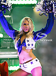 The Dallas Cowboys cheerleaders in action during the Thanksgiving Day game between the Miami Dolphins and the Dallas Cowboys at the Cowboys Stadium in Arlington, Texas. Dallas defeats Miami 20 to 19...