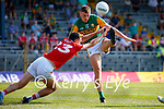 David Clifford, Kerry, in action against Mark Collins, Cork, during the Munster GAA Football Senior Championship Final match between Kerry and Cork at Fitzgerald Stadium in Killarney on Sunday.