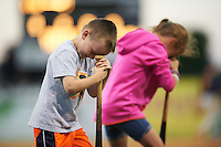 Batavia Muckdogs young fans participate in the dizzy bat tire race on field promotion during a game against the State College Spikes on June 24, 2016 at Dwyer Stadium in Batavia, New York.  State College defeated Batavia 10-3.  (Mike Janes/Four Seam Images)