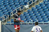 FOXBOROUGH, MA - AUGUST 7: Jon Bell #70 of New England Revolution II heads the ball during a game between Orlando City B and New England Revolution II at Gillette Stadium on August 7, 2020 in Foxborough, Massachusetts.
