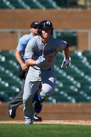 Glendale Desert Dogs second baseman Brandon Dixon (3) runs to first during an Arizona Fall League game against the Surprise Saguaros on October 23, 2015 at Salt River Fields at Talking Stick in Scottsdale, Arizona.  Glendale defeated Surprise 9-6.  (Mike Janes/Four Seam Images)
