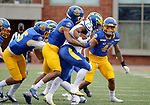BROOKINGS, SD - MAY 8: Quincy Watson #23 of the Delaware Fightin Blue Hens is brought down by a host of defenders from the South Dakota State Jackrabbits on May 8, 2021 in Brookings, South Dakota. (Photo by Dave Eggen/Inertia)