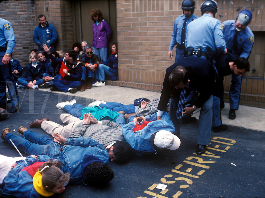 Police arrest anti abortion activists outside a family planning facility