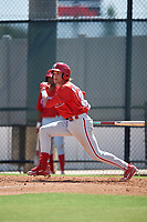Philadelphia Phillies Simon Muzziotti (31) follows through on a swing a Florida Instructional League game against the Atlanta Braves on October 5, 2018 at the Carpenter Complex in Clearwater, Florida.  (Mike Janes/Four Seam Images)