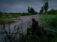 A mannequin dressed as the Grim Reaper standing on the frontline. Such figures are placed along the frontline, dressed with helmets and uniforms, to fool and expose enemy snipers. This one, at a Ukrainian checkpoint outside the war torn city of Pisky, is just dark humor.