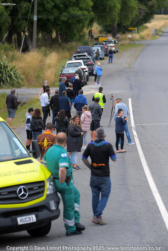 Fans wait outside the Gladstone Inn during stage two of the NZ Cycle Classic UCI Oceania Tour (Gladstone circuit) in Wairarapa, New Zealand on Thursday, 16 January 2020. Photo: Dave Lintott / lintottphoto.co.nz