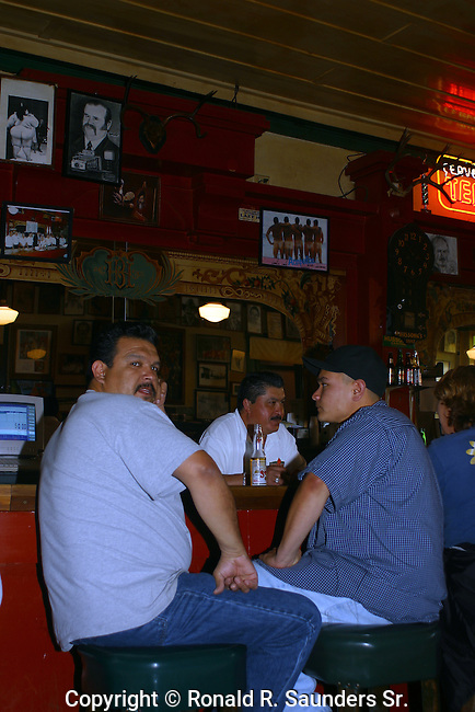 TWO MEN STOP IN FOR A BEER at the FAMOUS HUSSONG'S BAR. It is the OLDEST and BEST CANTINA in ALL MEXICO. HUSSONG's is BELIEVED to be the PLACE WHERE the MARGARITA was CREATED. In 1941 BARTENDER DON CARLOS OROZCO CONCOCTED the PERFECT MIXTURE of EQUAL PARTS TEQUILA and LIME, SERVED OVER ICE in a SALT-RIMMED GLASS for MARGARITA HENKEL, DAUGHTER of the GERMAN AMBASSADOR to MEXICO.